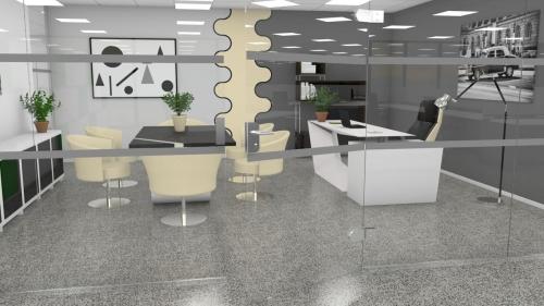 Kontor med slipt betonggulv i grå og sort samt UV lakk